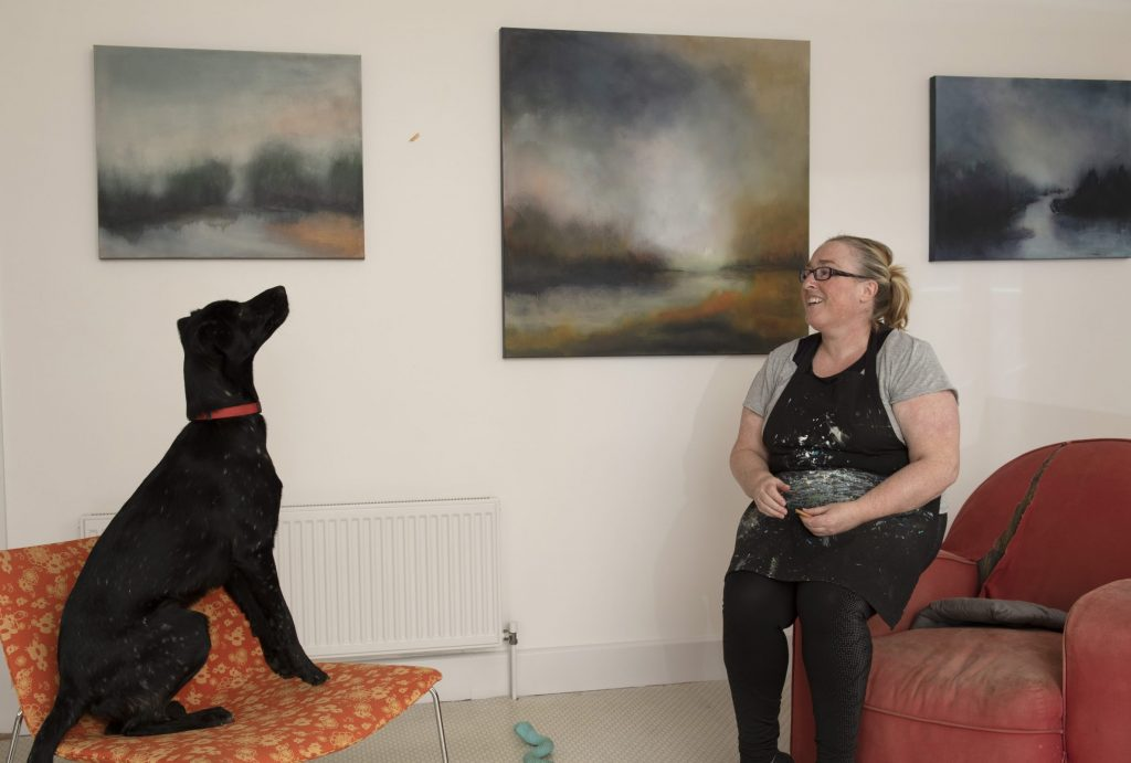 Helen and her dog Missy in her home studio